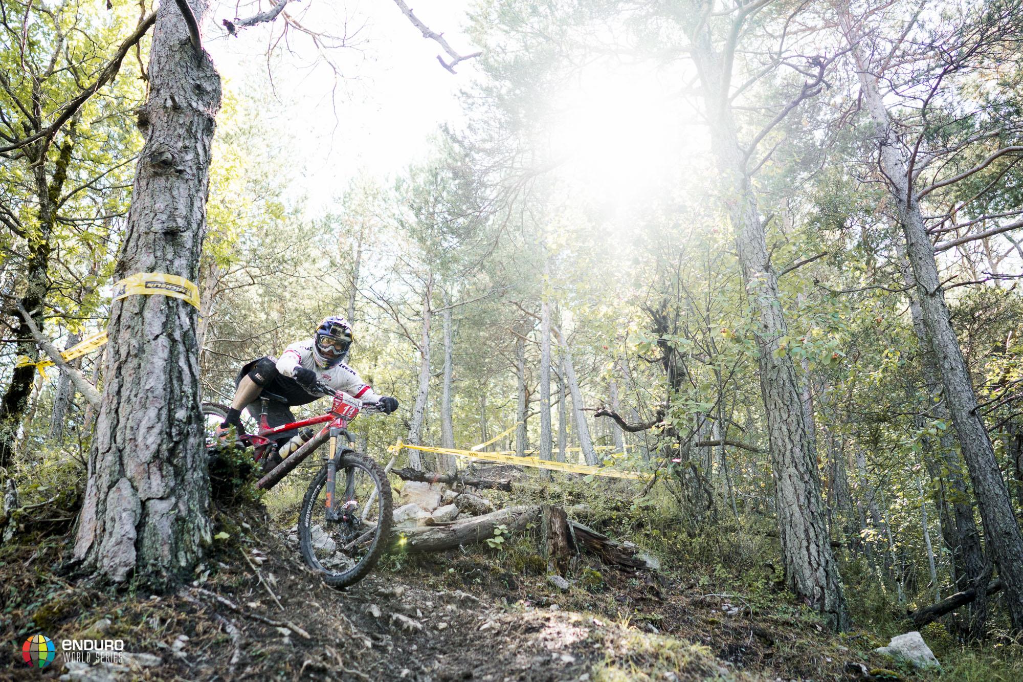 Rene Wildhaber wrestles his bike around a line